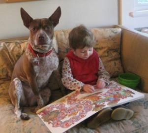 boy rading to dog