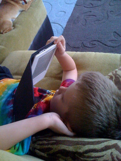 boy reading kindle
