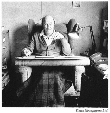 Roald Dahl sitting in his writing hut.