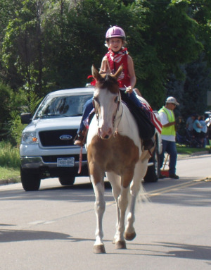 This is me riding my horse in the Fourth of July Parade!